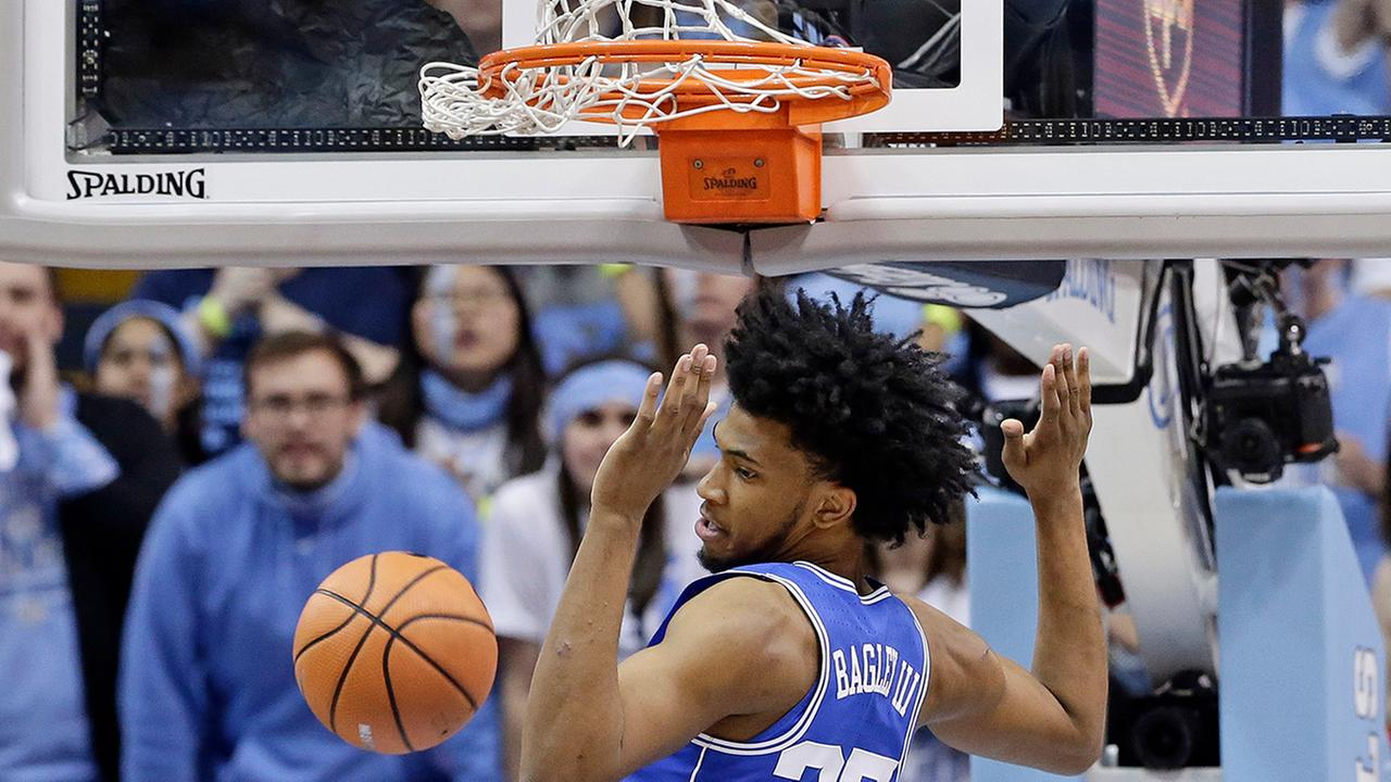 Dukes Marvin Bagley III finishes off a dunk against North Carolina.Gerry Broome