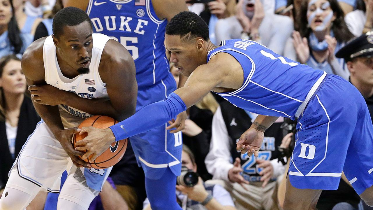 North Carolinas Theo Pinson controls the ball while Dukes Trevon Duval reaches in.Gerry Broome