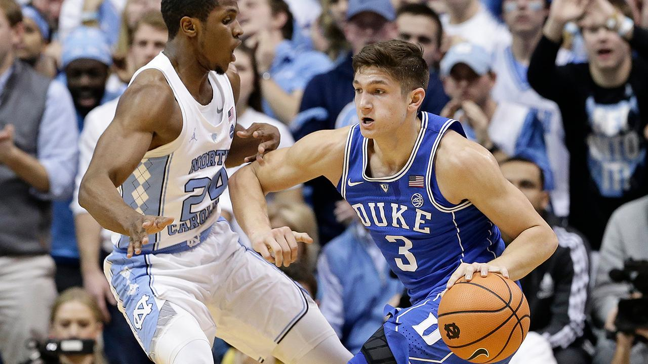 North Carolinas Kenny Williams guards against Dukes Grayson Allen.Gerry Broome