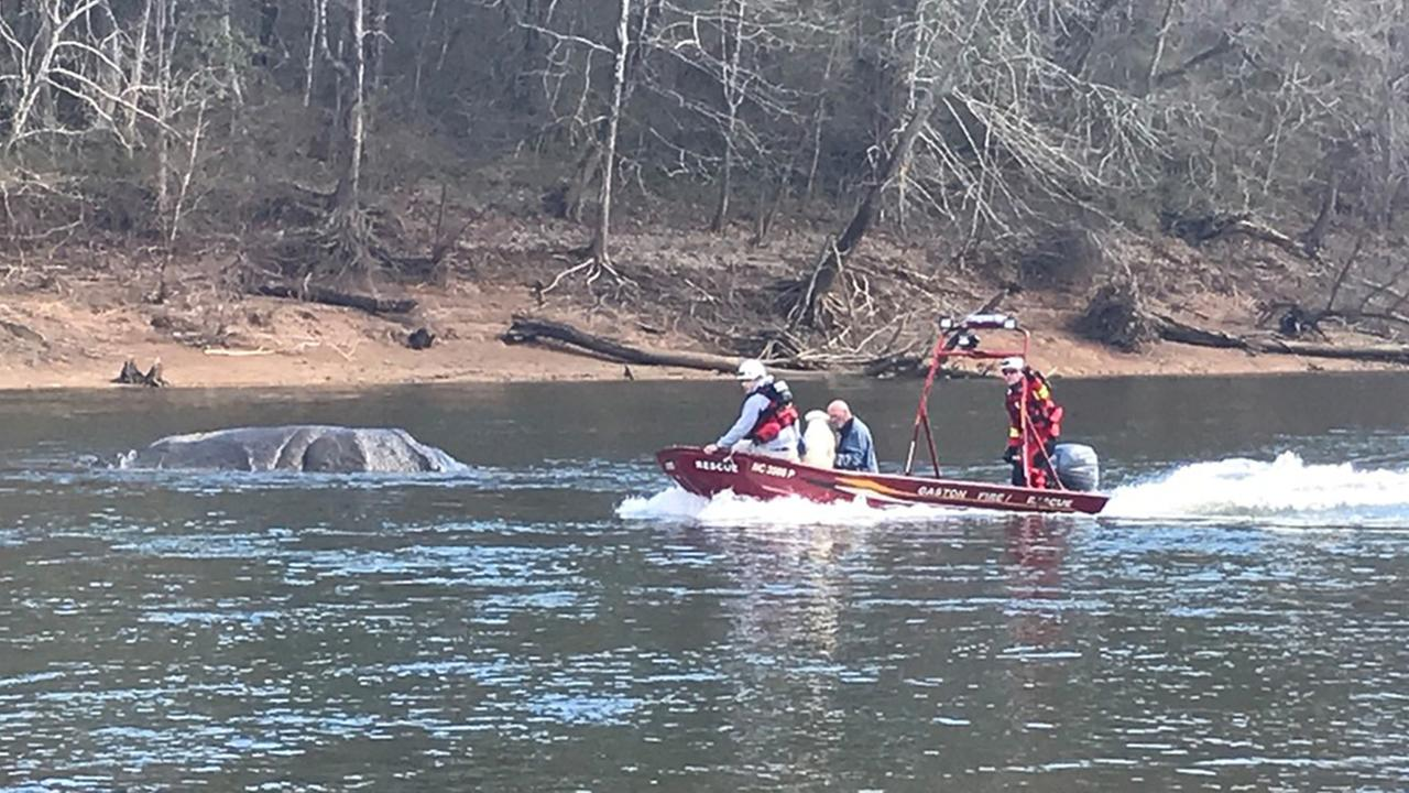 Crews rescue 2 men and dog from Roanoke River
