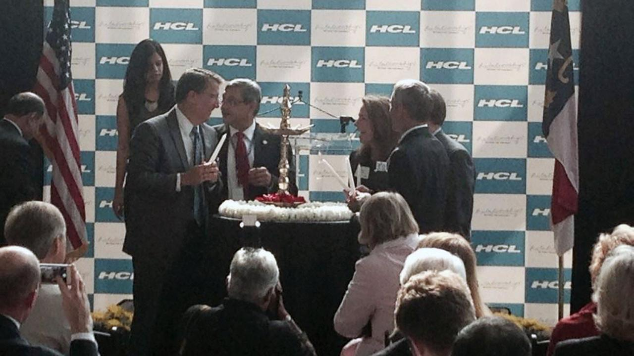 Gov. McCrory helps in traditional lamp lighting ceremony at HCLs jobs announcement Thursday.