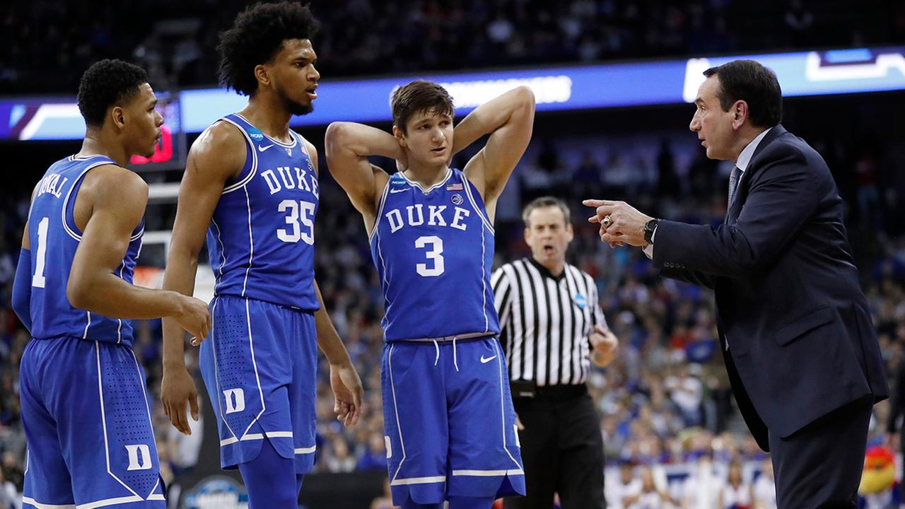 Duke head coach Mike Krzyzewski, right, talks with Grayson Allen (3), Marvin Bagley III (35) and Trevon Duval (1) during the second half of a regional final game against Kansas.