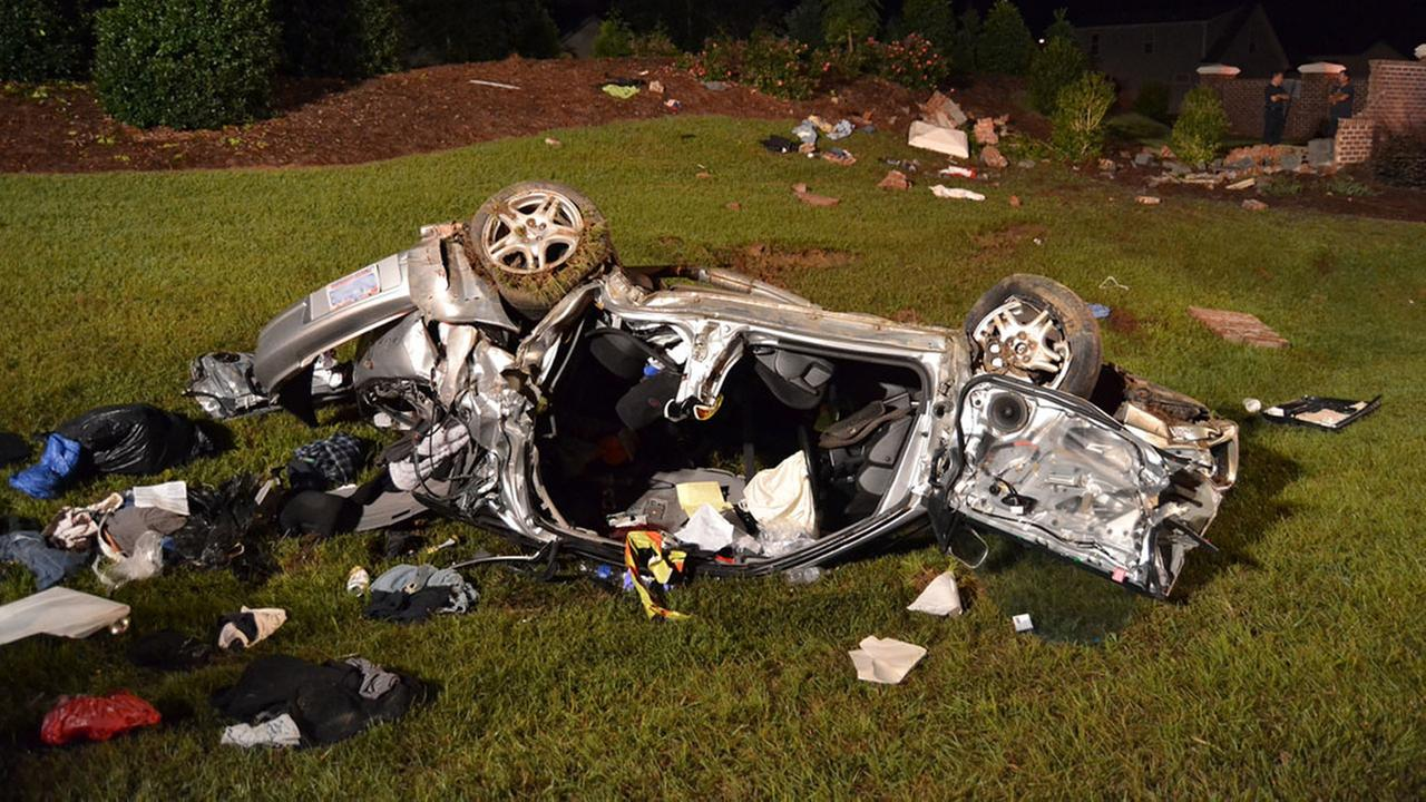 A man was seriously injured late Tuesday night when his car rolled over several times before hitting a brick wall.
