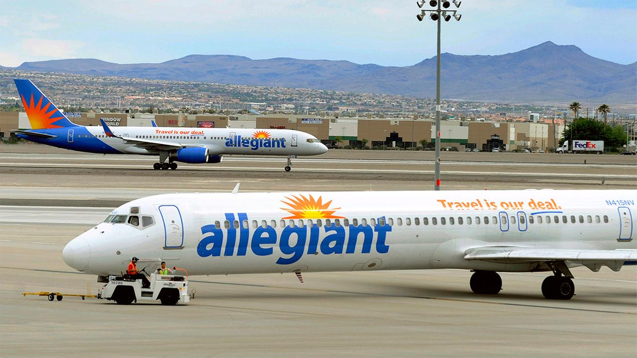 In this May 9, 2013, photo, two Allegiant Air jets taxi at McCarran International Airport in Las Vegas.