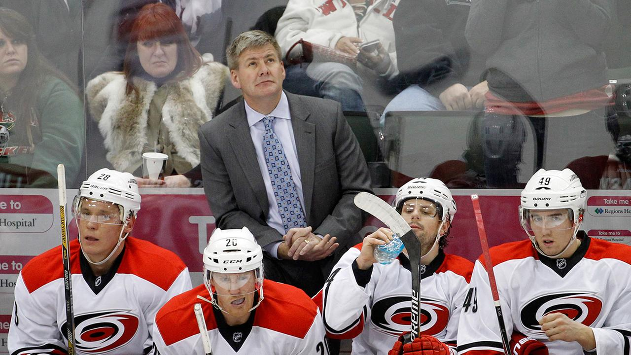 File photo. Carolina Hurricanes head coach Bill Peters checks the scoreboard during the third period of an NHL hockey game.
