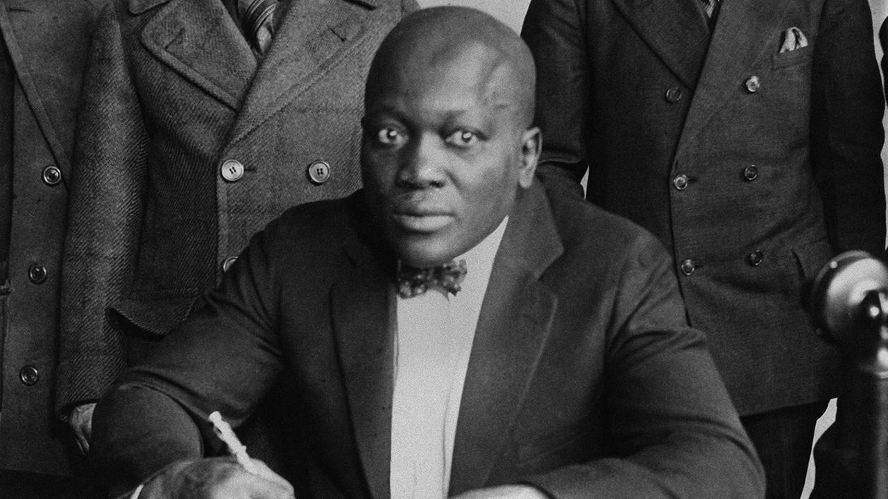 Boxer Jack Johnson is shown signing contracts in this undated photo.