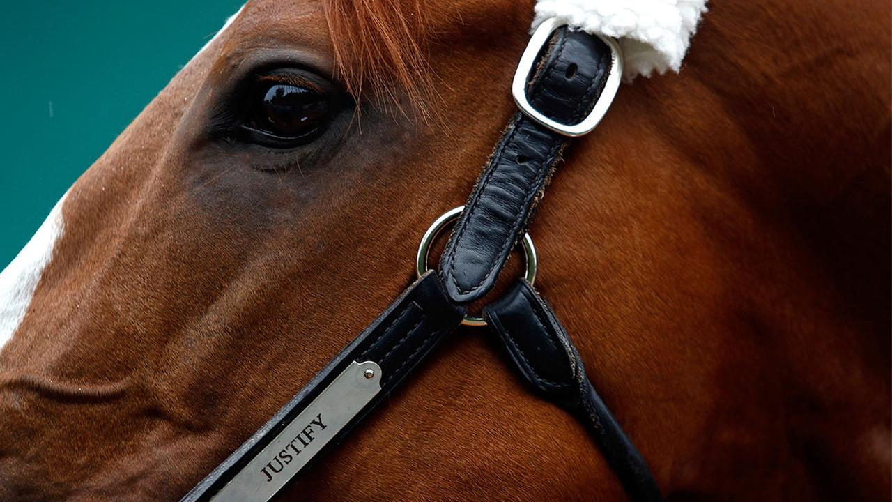Justify wins Belmont to become 13th Triple Crown champ