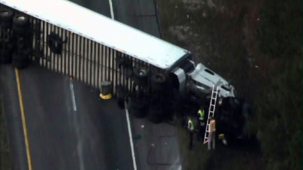 An overturned tractor-trailer is blocking both lanes of southbound Interstate 95 near exit 65 in Godwin.