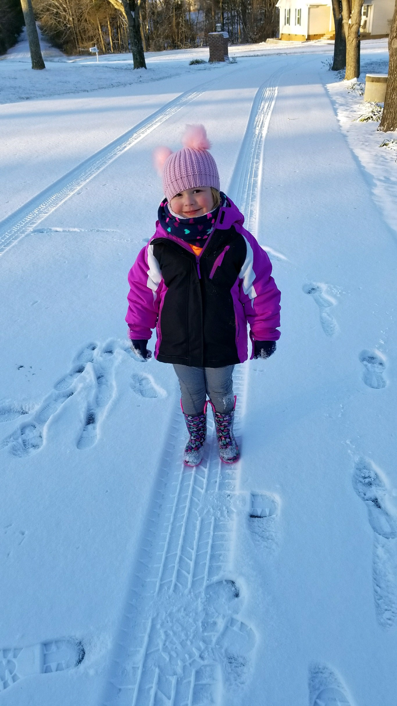 <div class='meta'><div class='origin-logo' data-origin='none'></div><span class='caption-text' data-credit='Credit: Marsha Rudd'>3-year-old Isla Williams enjoying the snow in Mebane</span></div>