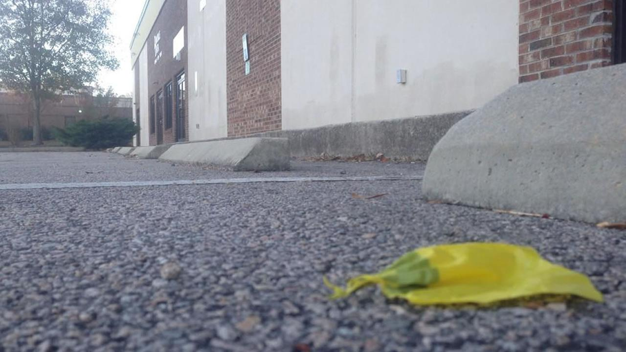 A piece of crime tape remains at the parking lot in the 10500 block of Ligon Mill Road.