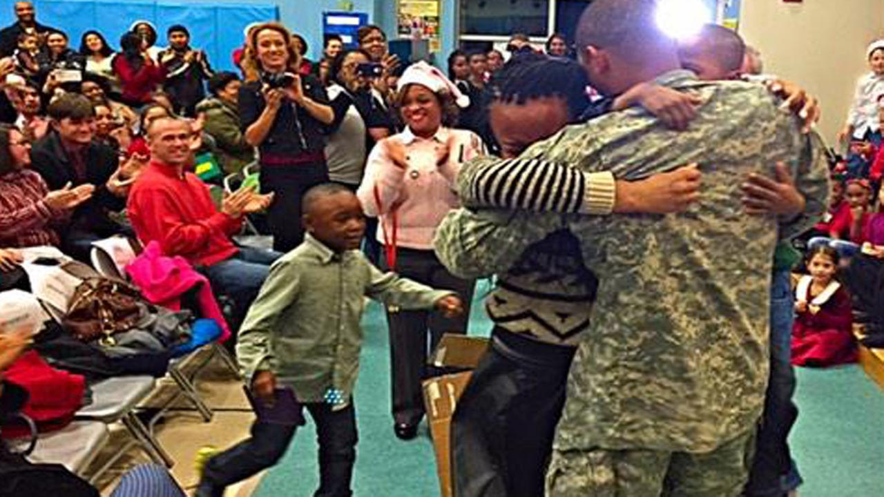 These kids faces were priceless when they saw their deployed soldier-dad unwrapped at a school concert Thursday night.