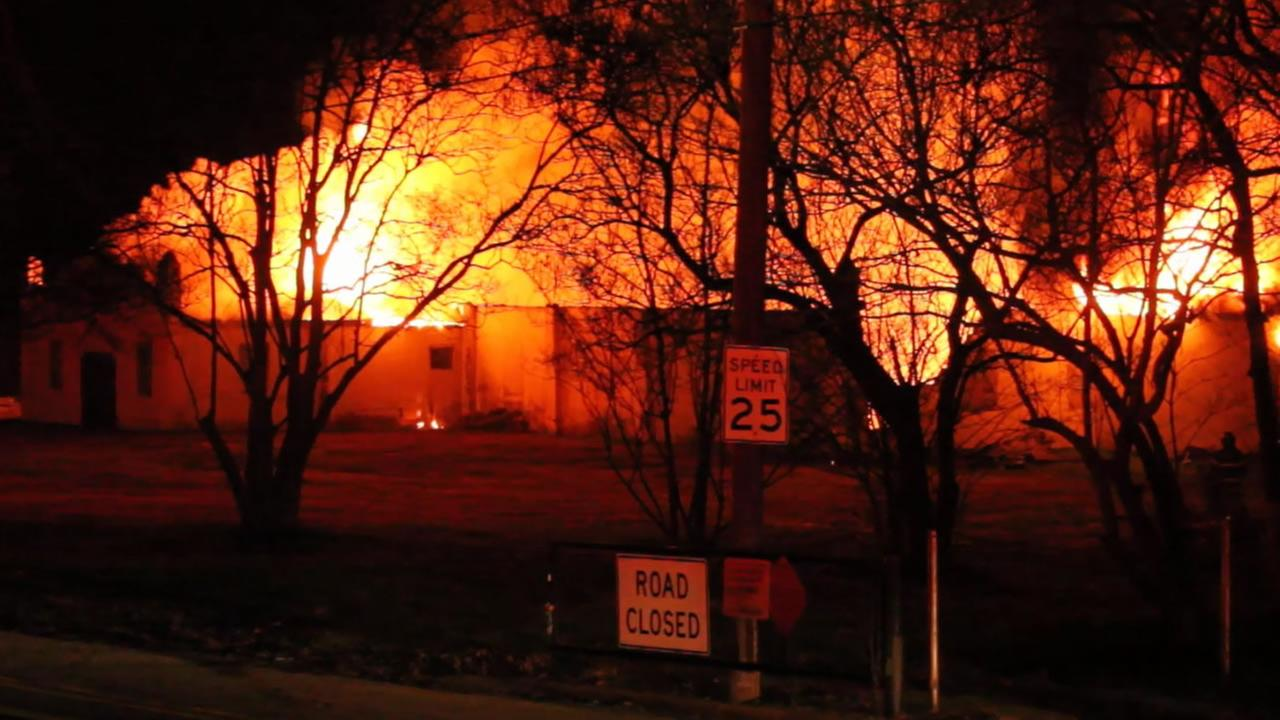 Investigators said the warehouse-style building was fully involved in flames when firefighters arrived.