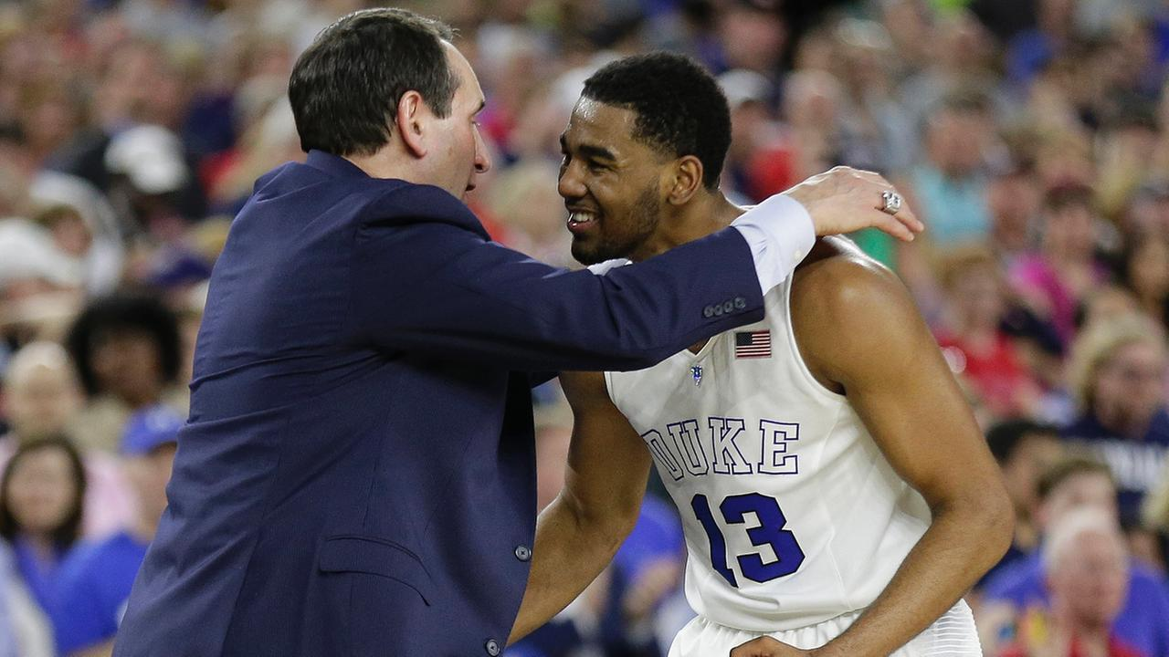 Duke head coach Mike Krzyzewski celebrates with Matt Jones after the second half of a college basketball regional final game against Gonzaga in the NCAA Tournament Sunday