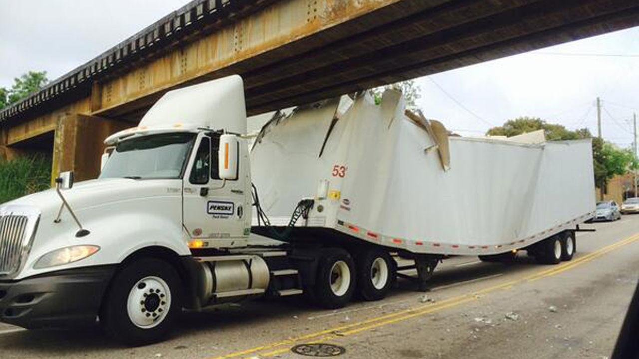 Truck stuck under Peace Street railroad bridge