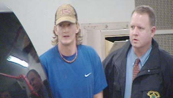 <div class='meta'><div class='origin-logo' data-origin='none'></div><span class='caption-text' data-credit=''>Jason Young was transported to the magistrate's office in Raleigh on Monday, December 14, 2009.</span></div>