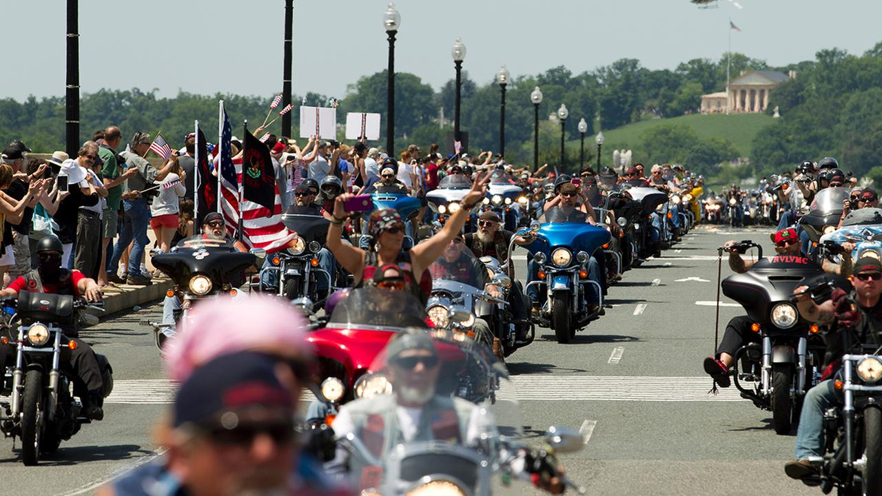 Participants in the Rolling Thunder annual motorcycle rally ride past Arlington Memorial Bridge
