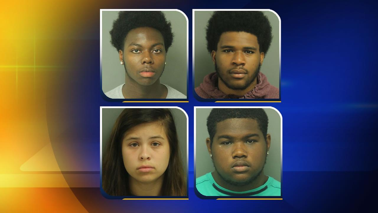 Four people are charged in a hit-and-run that left a Cary high school student dead.