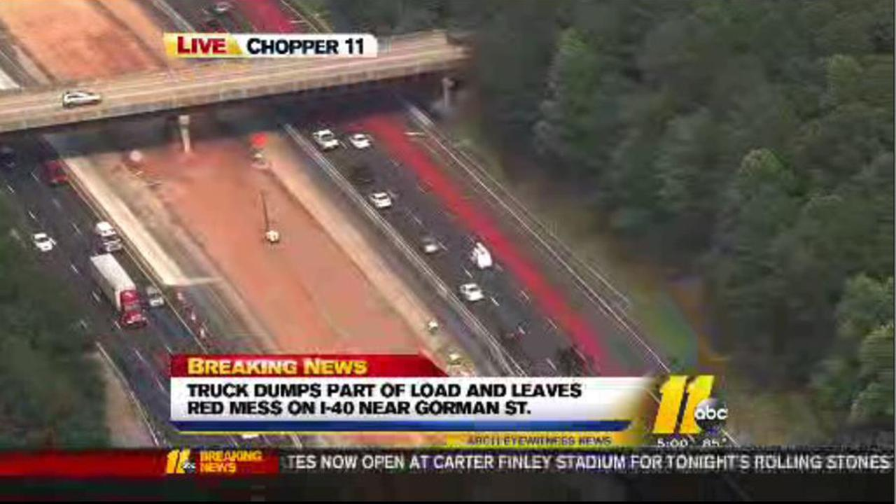 Truck dumps part of load and leaves red mess on I-40 near Gorman Street