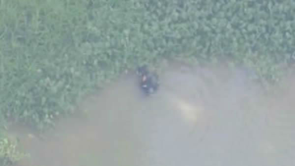 <div class='meta'><div class='origin-logo' data-origin='none'></div><span class='caption-text' data-credit='KTRK Photo'>Divers search Oyster Creek near Skinner Lane in Richmond, Texas Monday July 25. Human remains were found in the creek the day before.</span></div>