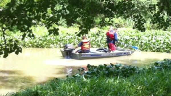 <div class='meta'><div class='origin-logo' data-origin='none'></div><span class='caption-text' data-credit='Photo/KTRK Photo'>Divers search Oyster Creek near Skinner Lane in Richmond, Texas Monday July 25. Human remains were found in the creek the day before.</span></div>