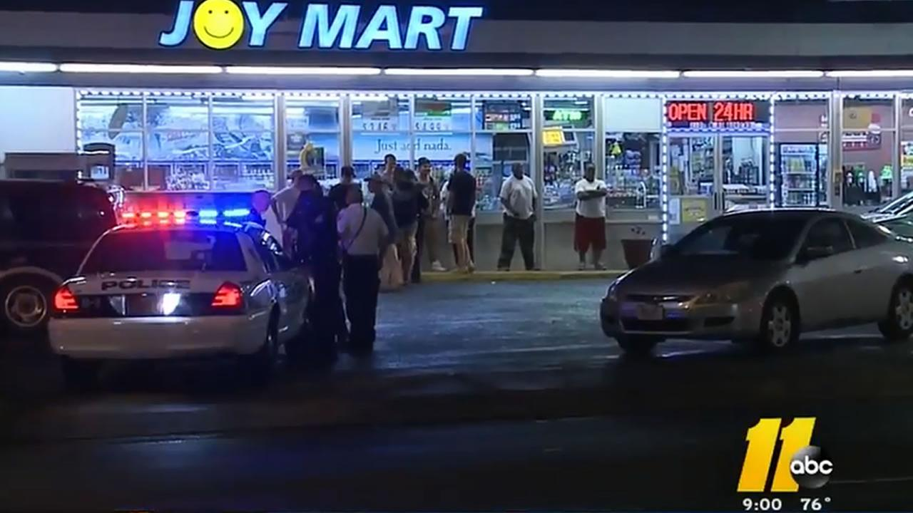 Police investigate at the Joy Food Mart at 2109 North Roxboro Street.