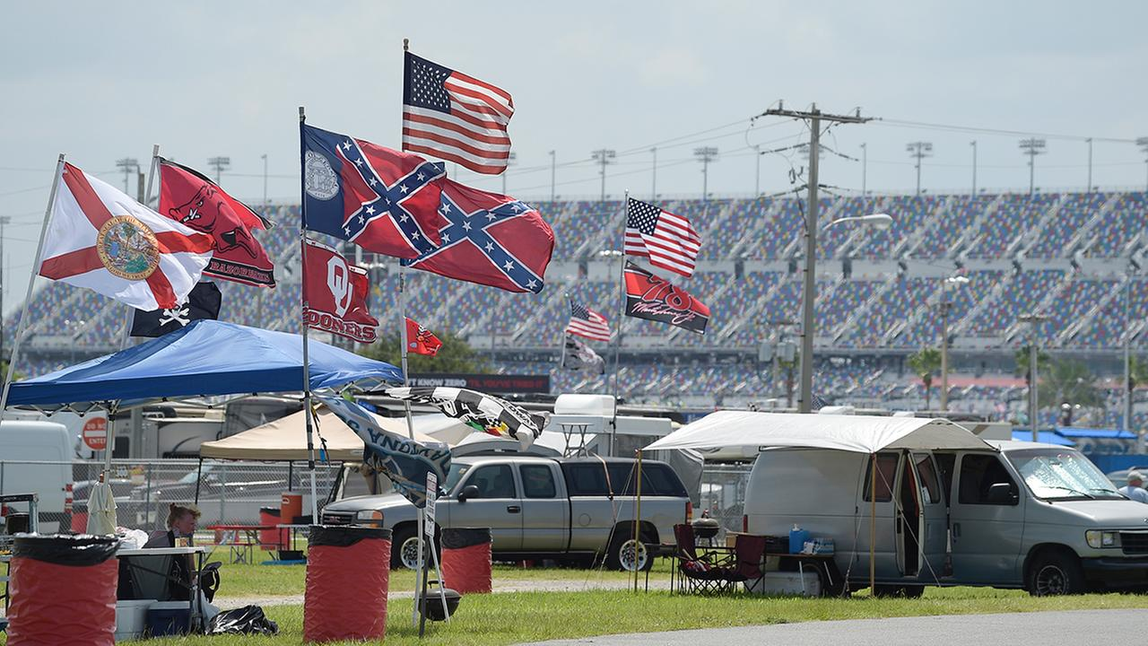 Confederate, American and other flags fly on top of motor homes at Daytona International Speedway, Saturday, July 4, 2015, in Daytona Beach, Fla.