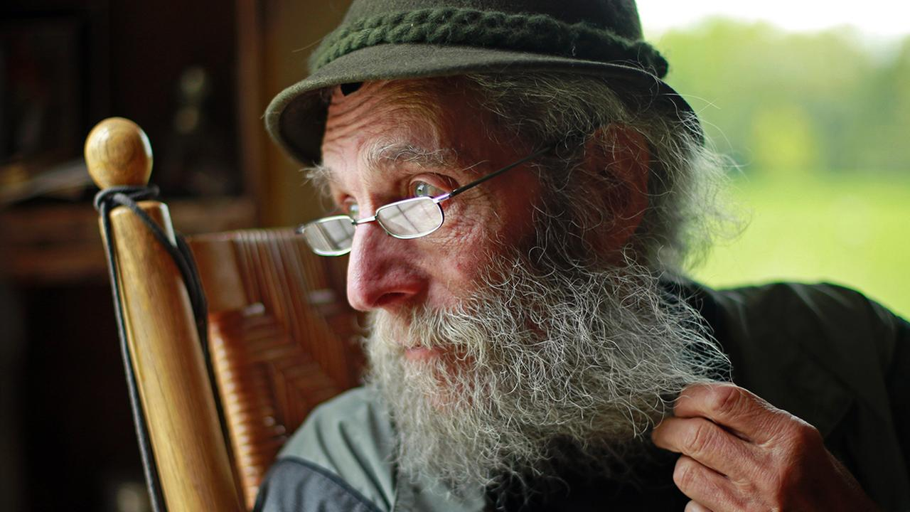 In this photo taken on Friday, May 23, 2014, Burt Shavitz pauses during an interview to watch a litter of fox kits. Shavitz, a former beekeeper, is the Burt behind Burts Bees