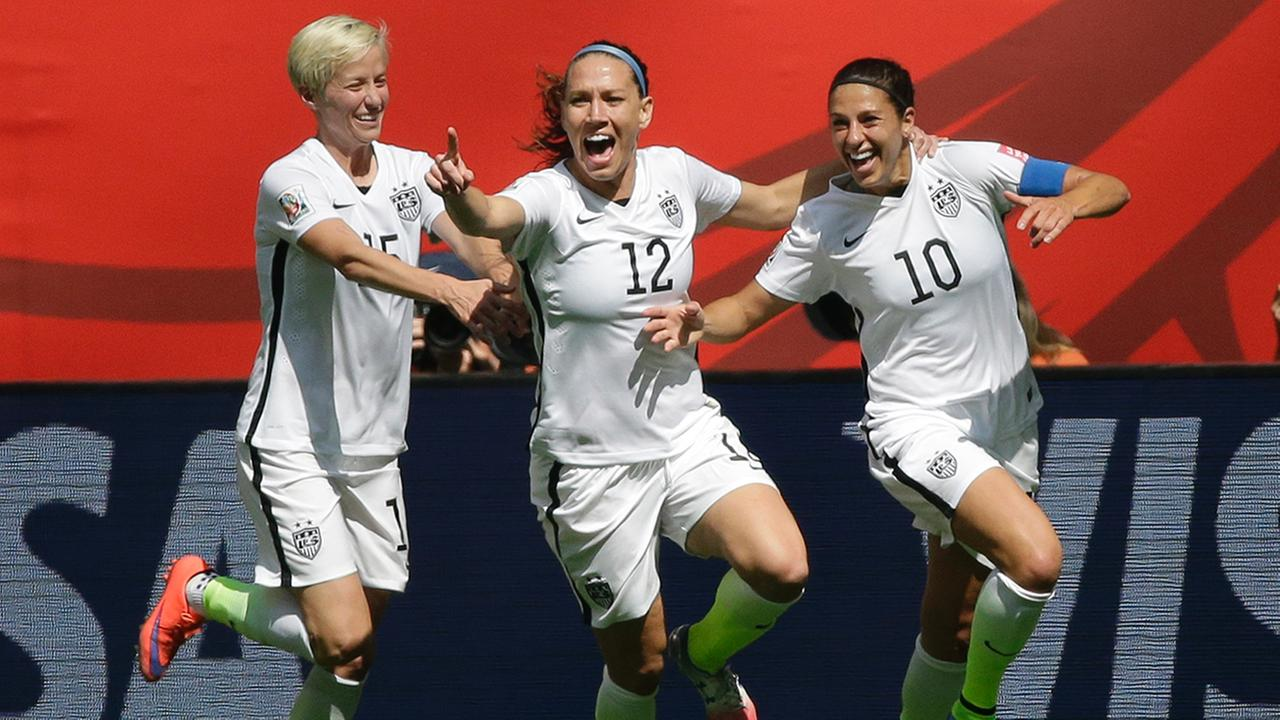 From left, United States Megan Rapinoe, Lauren Holiday, and Carli Lloyd celebrate after Lloyd scored her second goal of the match against Japan during the first half of the FIFA Womens World Cup soccer championship in Vancouver, British Columbia, Canada