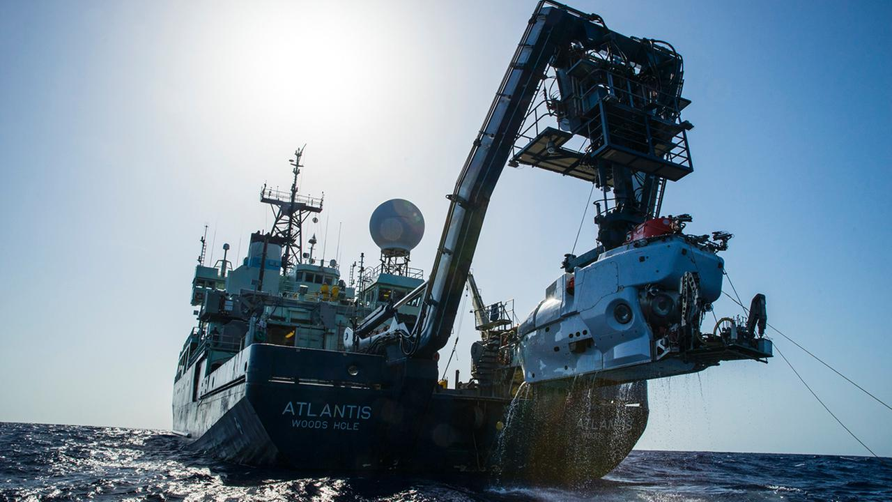 The research vessel Atlantis with the submersible Alvin hanging off its stern.