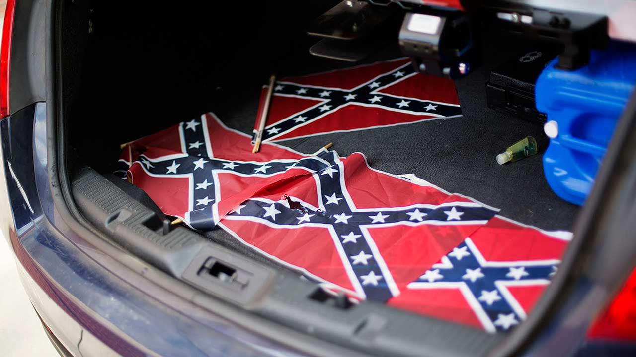 Confederate flags sit in the back of a police car outside Ebenezer Baptist Church Thursday, July 30, 2015, in Atlanta.