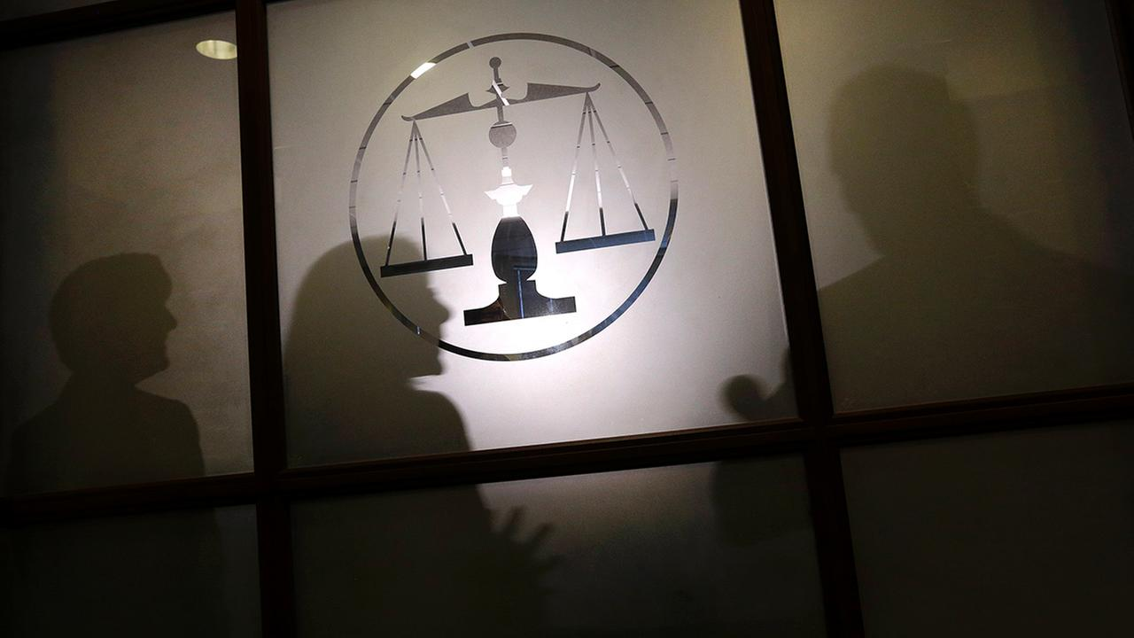 Lawmakers silhouetted while debating