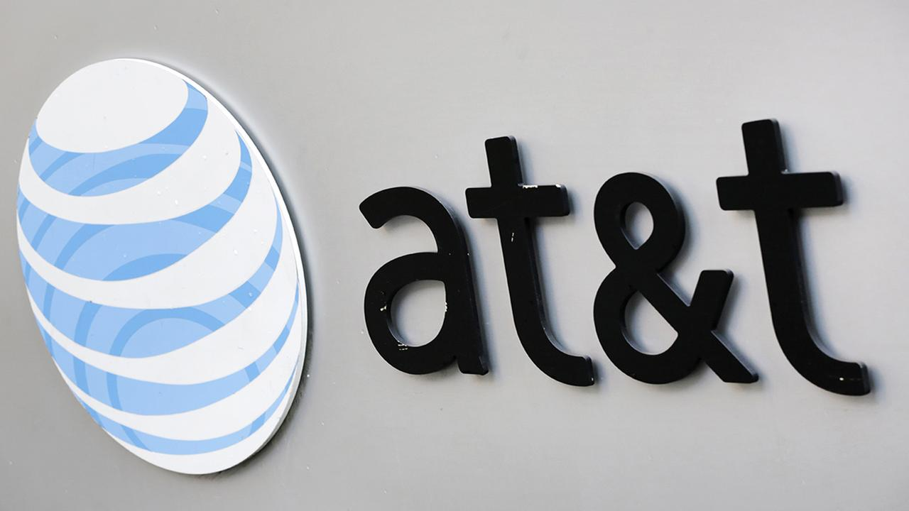 The corporate logo for AT&T is shown on the outside of one of its New York facilities