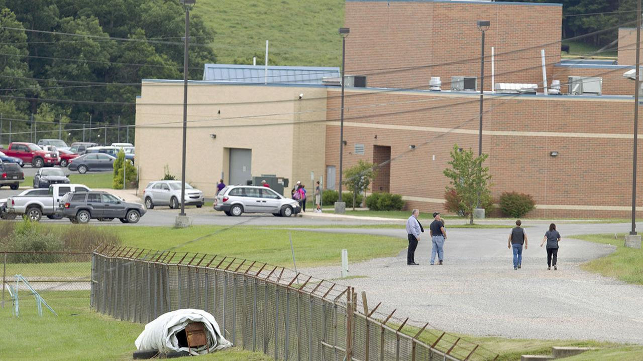 Parents of children from Philip Barbour High School in Philippi, W.v.,walk to the school to meet up with their children that were evacuated after a hostage-like situation