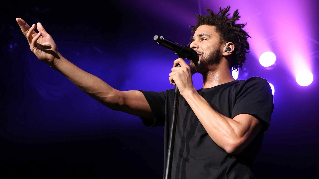 J. Cole performs at Aarons Amphitheatre at Lakewood on Saturday, August 15, 2015, in Atlanta.