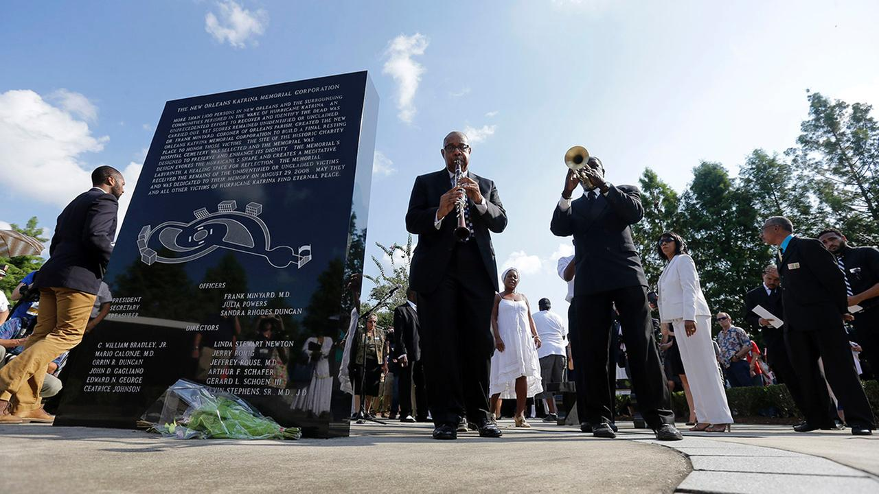 Musicians lead the procession during a wreath laying ceremony at the Hurricane Katrina Memorial, on the 10th anniversary of Hurricane Katrina in New Orleans