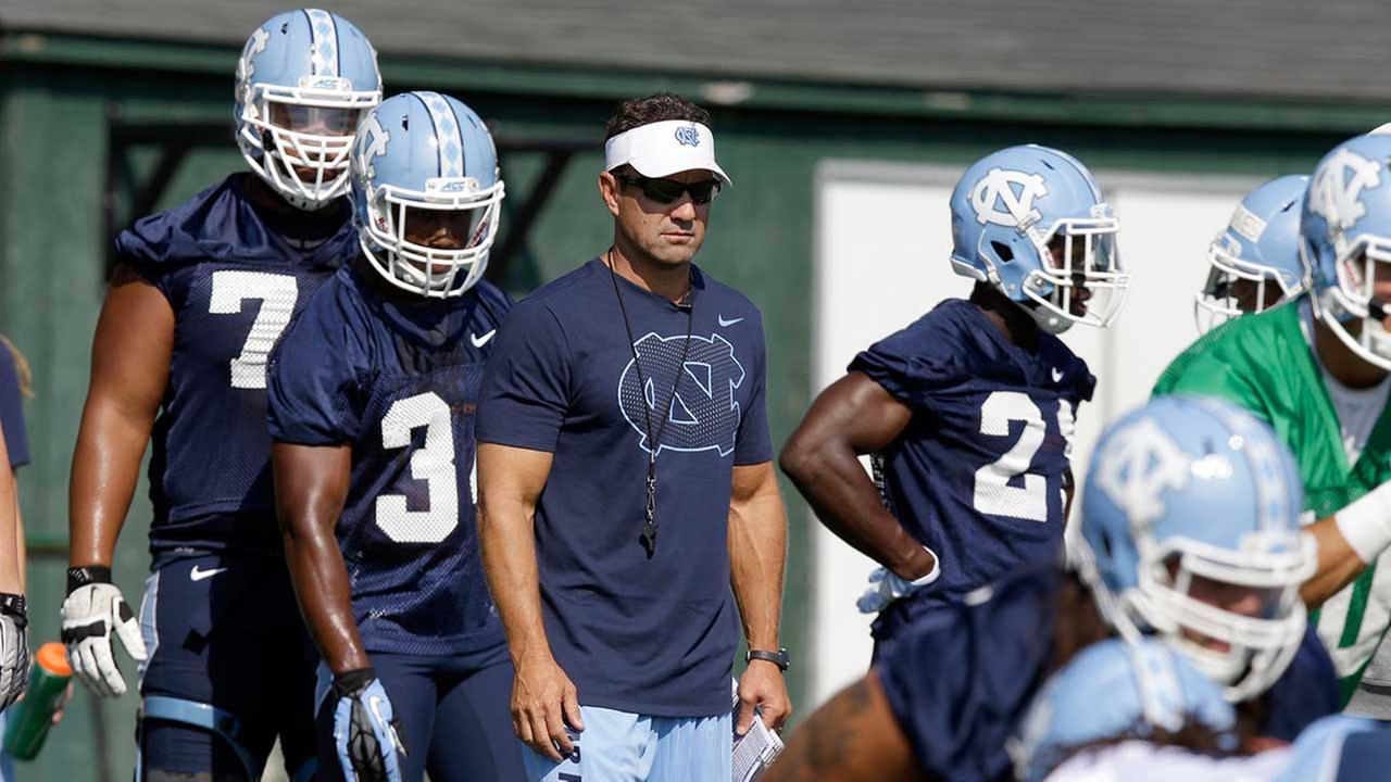 North Carolina coach Larry Fedora watches drills during the teams first NCAA college football practice of the season in Chapel Hill, N.C., Monday, Aug. 3, 2015.