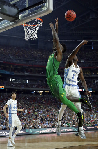 "<div class=""meta image-caption""><div class=""origin-logo origin-image none""><span>none</span></div><span class=""caption-text"">North Carolina's Theo Pinson (1) blocks a shot by Oregon's Jordan Bell (AP Photo/David J. Phillip) (AP)</span></div>"
