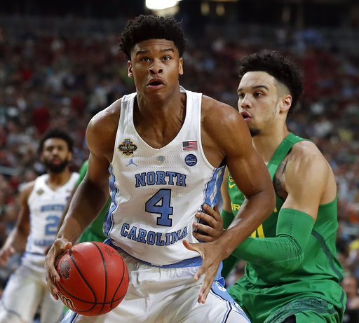 "<div class=""meta image-caption""><div class=""origin-logo origin-image none""><span>none</span></div><span class=""caption-text"">North Carolina's Isaiah Hicks (4) drives against Oregon's Keith Smith (AP Photo/Charlie Neibergall) (AP)</span></div>"