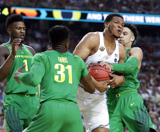 "<div class=""meta image-caption""><div class=""origin-logo origin-image none""><span>none</span></div><span class=""caption-text"">North Carolina's Kennedy Meeks drives between Oregon's Dylan Ennis (31) and Dillon Brooks (AP Photo/Mark Humphrey) (AP)</span></div>"