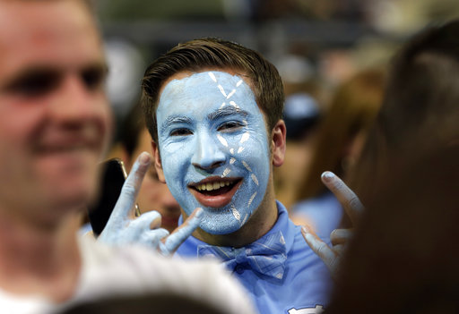 "<div class=""meta image-caption""><div class=""origin-logo origin-image none""><span>none</span></div><span class=""caption-text"">A North Carolina fan cheers (AP Photo/David J. Phillip) (AP)</span></div>"