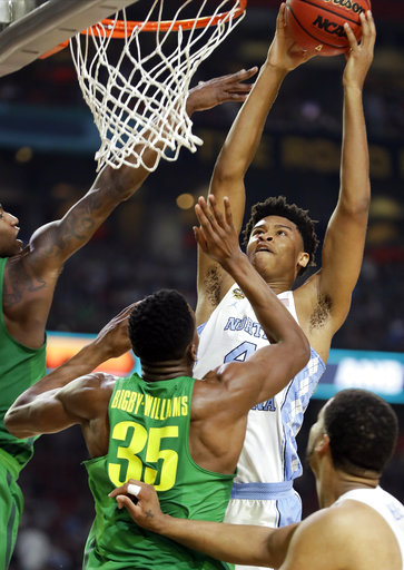 "<div class=""meta image-caption""><div class=""origin-logo origin-image none""><span>none</span></div><span class=""caption-text"">North Carolina's Isaiah Hicks (4) goes up for a basket against Oregon's Kavell Bigby-Williams (35) (AP Photo/Mark Humphrey)</span></div>"