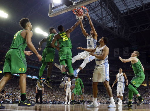 "<div class=""meta image-caption""><div class=""origin-logo origin-image none""><span>none</span></div><span class=""caption-text"">North Carolina's Isaiah Hicks (4) dunks over Oregon's Jordan Bell (1) and Kavell Bigby-Williams (35)  (AP Photo/Mark Humphrey)</span></div>"