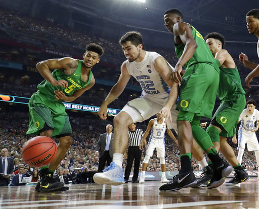 "<div class=""meta image-caption""><div class=""origin-logo origin-image none""><span>none</span></div><span class=""caption-text"">North Carolina's Luke Maye (32) chases a loose ball (AP Photo/David J. Phillip)</span></div>"