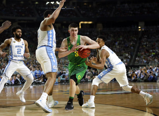 "<div class=""meta image-caption""><div class=""origin-logo origin-image none""><span>none</span></div><span class=""caption-text"">Oregon's Payton Pritchard (3) drives between North Carolina's Kennedy Meeks, left, and Nate Britt  (AP Photo/Mark Humphrey)</span></div>"