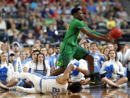"<div class=""meta image-caption""><div class=""origin-logo origin-image none""><span>none</span></div><span class=""caption-text"">Oregon's Dylan Ennis chases a loose ball as North Carolina's Joel Berry II (2) falls (AP Photo/Charlie Neibergall)</span></div>"