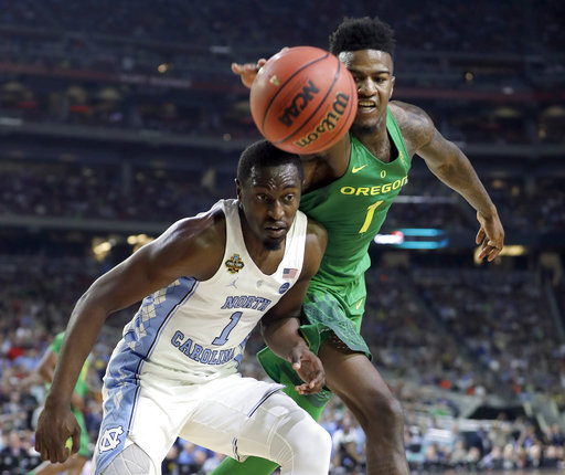 "<div class=""meta image-caption""><div class=""origin-logo origin-image none""><span>none</span></div><span class=""caption-text"">Oregon's Jordan Bell, right, cheese a loose ball against North Carolina's Theo Pinson  (AP Photo/Mark Humphrey)</span></div>"