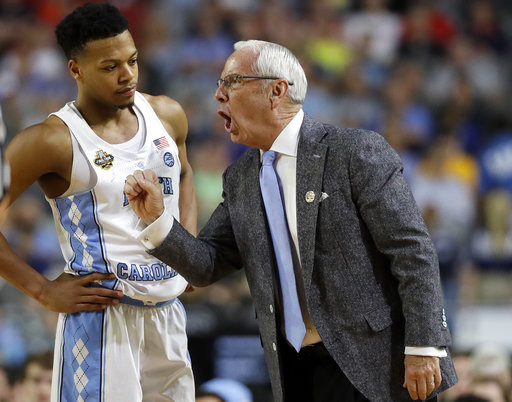"<div class=""meta image-caption""><div class=""origin-logo origin-image none""><span>none</span></div><span class=""caption-text"">North Carolina head coach Roy Williams, right talks to Nate Britt. (AP Photo/Mark Humphrey)</span></div>"