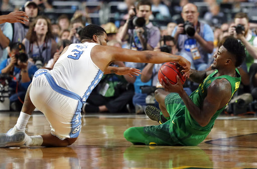 "<div class=""meta image-caption""><div class=""origin-logo origin-image none""><span>none</span></div><span class=""caption-text"">North Carolina's Kennedy Meeks (3) battles for the possession of the ball against Oregon's Jordan Bell  (AP Photo/Charlie Neibergall)</span></div>"