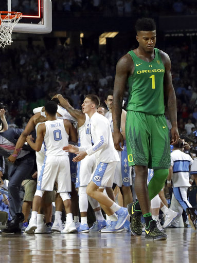 "<div class=""meta image-caption""><div class=""origin-logo origin-image none""><span>none</span></div><span class=""caption-text"">Oregon's Jordan Bell (1) walks off the court as North Carolina players celebrate (AP Photo/David J. Phillip)</span></div>"