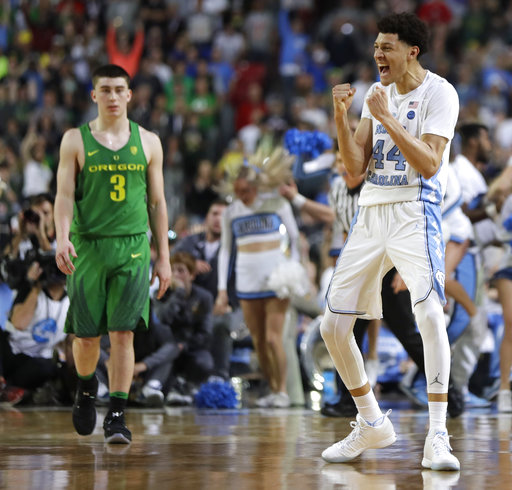 "<div class=""meta image-caption""><div class=""origin-logo origin-image none""><span>none</span></div><span class=""caption-text"">North Carolina forward Justin Jackson (44) celebrates in front of Oregon guard Payton Pritchard (3). (AP Photo/Mark Humphrey)</span></div>"
